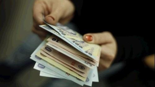 Foto: Românii au cel mai mic salariu din Europa - 158 de euro