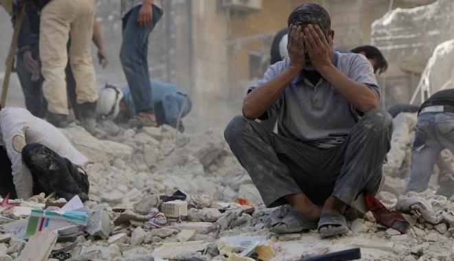 Foto: 11 civili, ucişi în raiduri aeriene în centrul Siriei