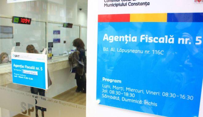 Foto: Impozitele şi taxele locale, plătite online,  pe platforma  www.ghiseul.ro