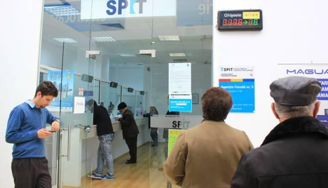Foto: Constănţenii s-au grăbit să-şi plătească impozitele şi taxele locale