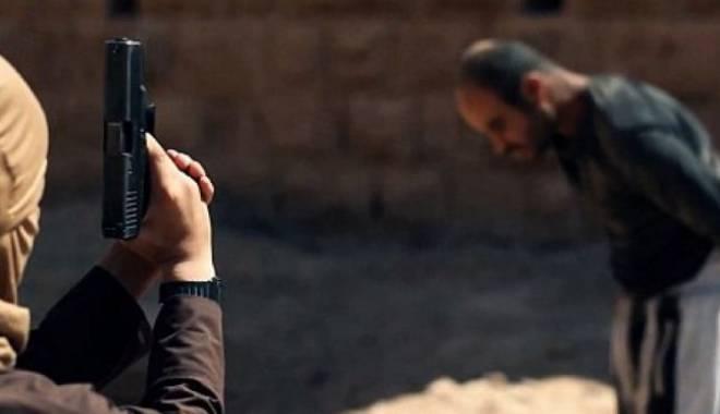 Foto: Macabru în Statul Islamic. Joc de-a v-aţi ascunselea cu prizonieri