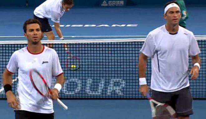 Foto: Tecău şi Rojer, eliminaţi rapid din turneul de la Sydney