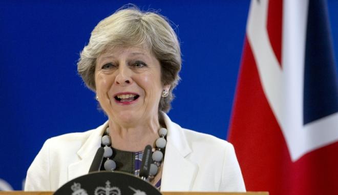 Foto: Theresa May pierde la limită un vot crucial în Parlament