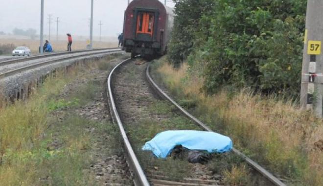 Foto: Femeie lovită mortal, de tren