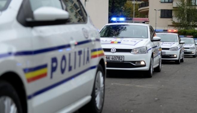 Foto: REŢINUŢI DE POLIŢIŞTI PENTRU ŞANTAJ