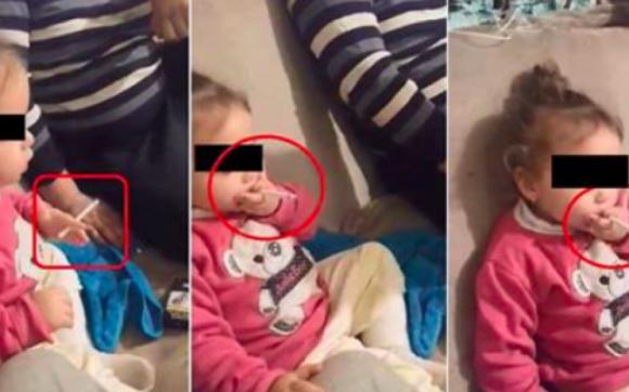 """Foto: CAZ REVOLTĂTOR! Fetiţă de 3 ani, pusă de părinţi să fumeze şi să bea cafea: """"Hai, trage, trage!"""""""