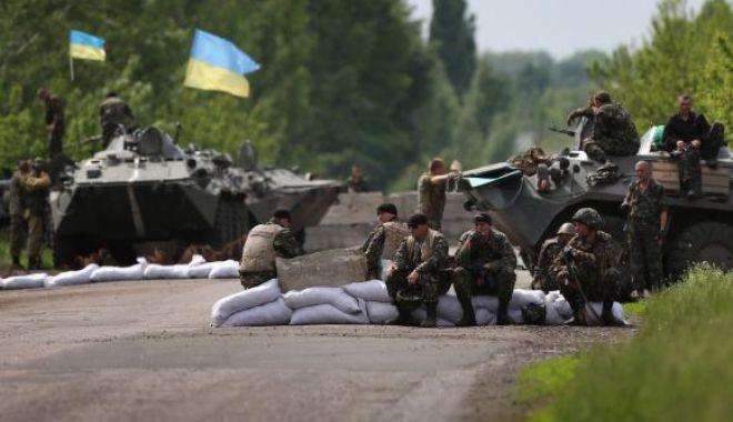 Foto: Trei soldaţi ucraineni au fost ucişi în estul ţării înainte de reluarea discuţiilor de pace