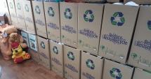 Let's Share & Care! 450 de copii vor primi haine, jucării şi alimente