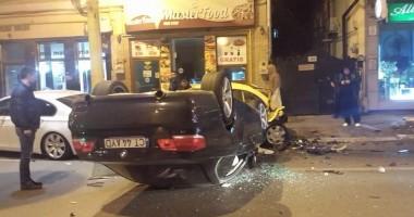 FOTO şi VIDEO / Un notar public constănţean a făcut praf CINCI maşini, după care s-a răsturnat cu BMW-ul / UPDATE