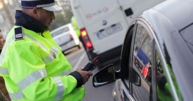 Femeie cu alcoolemie record şi fără permis, prinsă la volan