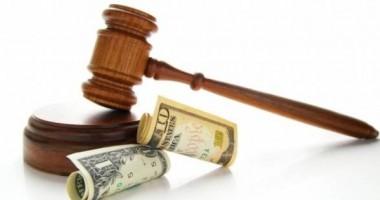 Patru mari companii au fost amendate, fiind acuzate de trucarea unor licitaţii