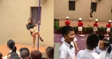Copiii dintr-o grădiniţă au fost întâmpinaţi în prima zi cu un dans profesionist la bară