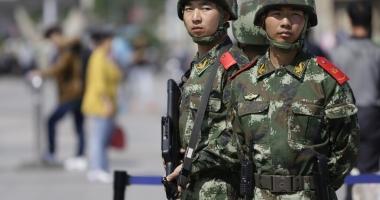 Atac armat în China. Două persoane, printre care şi primarul, au fost rănite