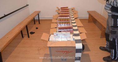 Doi cetățeni români cercetați pentru contrabandă și 16.900 de pachete cu țigări confiscate
