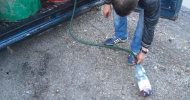 Băgați după gratii pentru cum furau motorina din rezervoarele TIR-urilor