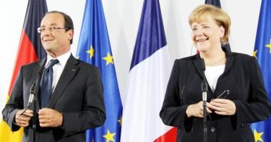 Hollande şi Merkel: Dineu de adio şi