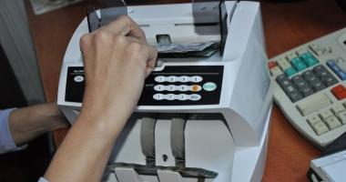 Poşta Română a cumpărat maşini de numărat bancnote