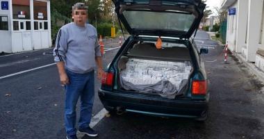 Prins la frontieră cu mii de pachete  de ţigări ascunse în portbagaj